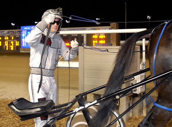 Tyler Smith comes into the winners circle after winning the second race driving Mileage Saturday night at Hoosier Park.