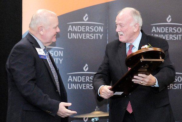 Don Knight/The Herald Bulletin<br /> The Herald Bulletin Publisher Henry Bird receives a commemorative wall clock from Bob Coffman as Bird was named this year's William P. Riethmiller Community Partnership Award recipient during the President's Annual Appreciation Dinner on Saturday.