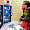 Highland Middle School 7th grader Brooklyn Duncan looks at a display showing the consequences of smoking during the Anderson Black Expo Teen Summit Saturday evening.