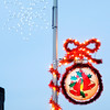 Don Knight/The Herald Bulletin<br /> Retro Christmas decorations hang from the light poles around the City Building on Wednesday. Local businessman Paul Bickel brought the old decorations out of storage to help celebrate the revival of the city's Christmas Parade.