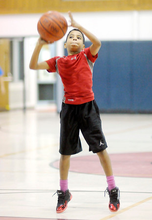 Don Knight/The Herald Bulletin<br /> Trey King, 10, shoots free throws during the Anderson Parks and Recreation Department's Turkey Shootout at the Geater Community Center on Wednesday. With Anderson Community Schools giving students the Wednesday off before Thanksgiving Michael B. Davis said the event was created to give kids something to do on the first day of their holiday vacation.