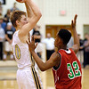 Lapel's Bailey Partington looks for a teammate as Anderson's Greg Dixon applies pressure.