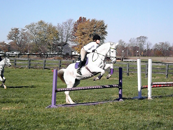 Our granddaughter, Madison Osbon, jumping at the horse show.<br /> <br /> Photographer's Name: J.R. Rosencrans<br /> Photographer's City and State: Alexandria, Ind.