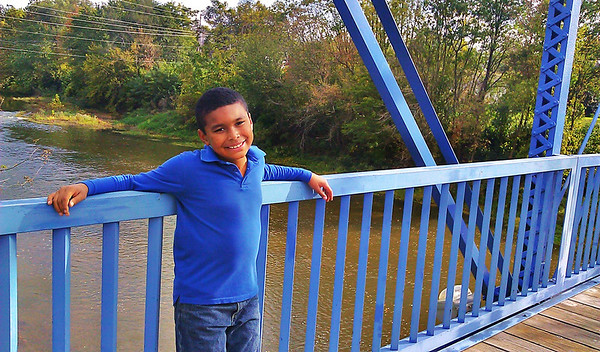 This is my youngest son Damarkis he is 8 and one of his favorite things to do is(go to the blue bridge ) thats how he puts it but we love to go down to the white river and enjoy the scenery thanks<br /> <br /> Photographer's Name: chalise clemons<br /> Photographer's City and State: anderson, IN