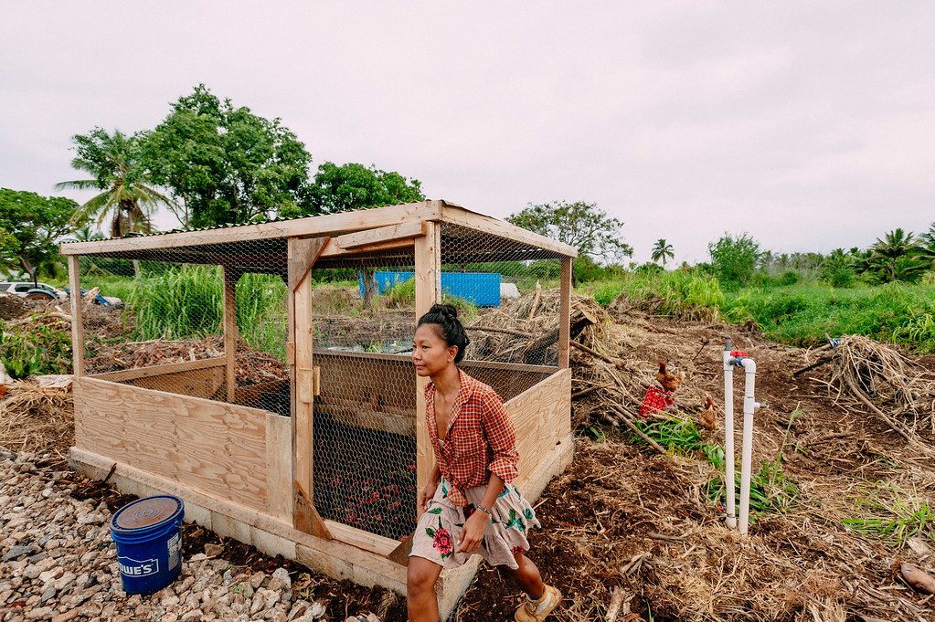 Counter Culture farmer Laarni Gedo gets to work early morning on the farm.