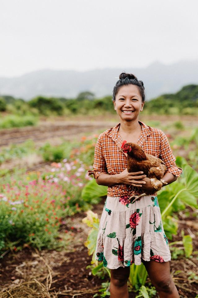 Counter Culture farmer Laarni Gedo with an egg producer early morning on the farm.