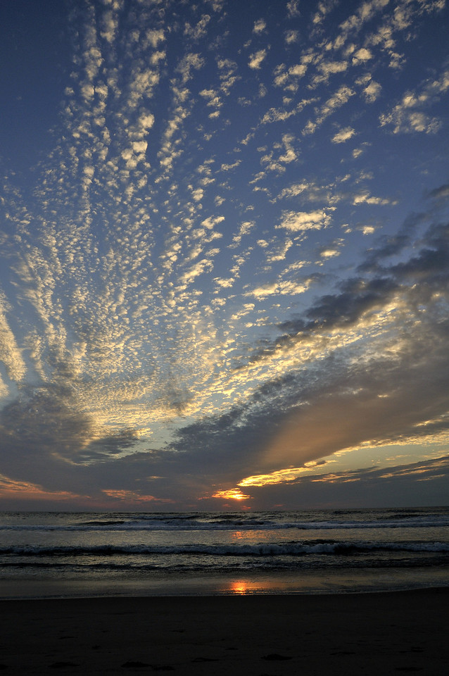 """These clouds have a distinct """"curl"""" to them as the first wave of clouds from the outer bands of Earl"""
