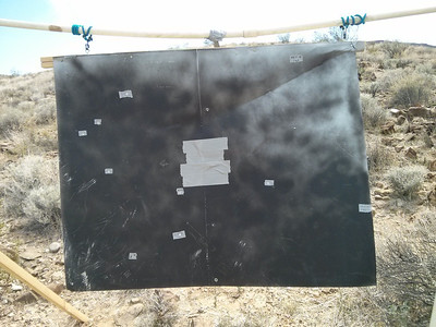 Another 1 Km hit down below the left edge of the duct tape Bulls Eye (not the close one).  I also marked the previous hit on the right edge of the steel.