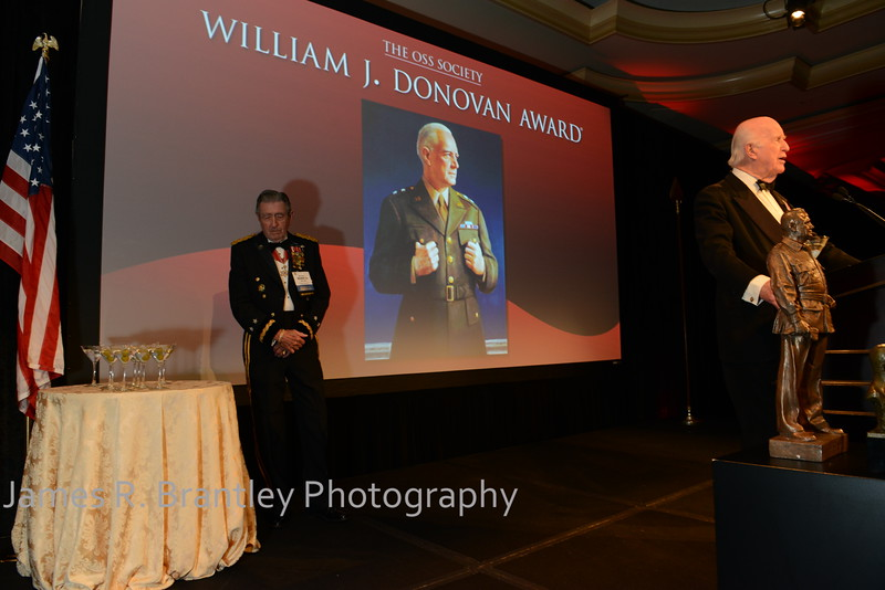 """The OSS Society presents the William J. Donovan Award to former CIA Director Bill Gates at the Ritz-Carlton Hotel in Washington, DC on Saturday, October 27, 2012.  The OSS (Office of Strategic Services) was the World War II era predecessor of today's Central Intelligence Agency.  The award is named for the first head of the OSS, William """"Wild Bill"""" Donovan.    (James R. Brantley)"""