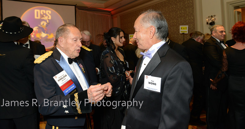 """Chairman of the OSS Society Major General Jack Singlaub, Paul Wong<br /> <br /> The OSS Society presents the William J. Donovan Award to former CIA Director Bill Gates at the Ritz-Carlton Hotel in Washington, DC on Saturday, October 27, 2012.  The OSS (Office of Strategic Services) was the World War II era predecessor of today's Central Intelligence Agency.  The award is named for the first head of the OSS, William """"Wild Bill"""" Donovan.    (James R. Brantley)"""