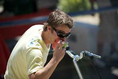 Ryan Littleton enjoys a juicy slice of watermelon at The OTR/Gateway Summer Celebration
