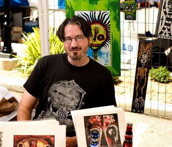 Artist JCobb displays his work at The OTR/Gateway Summer Celebration