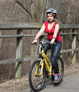 2013_03_10__Mirandi Schawn, 13 of Oberlin, enjoys the warm weather Sunday with a bike ride along the Inland Trail in Oberlin. photo by Ray Riedel
