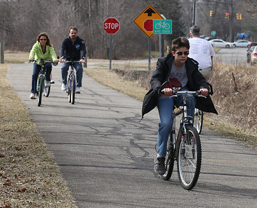 2013_03_10__Brad Hetrick, age 14 of Oberlin, leads his family along the Inland Trail bike path in Oberlin. photo by Ray Riedel