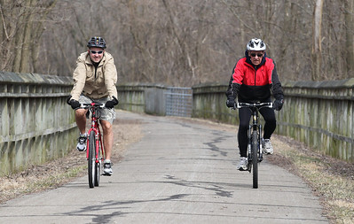2013_03_10__Ed Wood, of Oberlin, on the left, and his father Bill Wood of Louisville KY (red jacket) enjoy the nice weather Sunday with a bike ride on the Inland Trail in Oberlin. photo by Ray Riedel