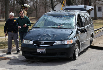 2013_03_10__The driver of the Honda Odessey and the Oberlin Police Sergeant declined to comment. The Odessey was struck by a Ford Taurus after the Honda allegedly failed to stop at a stop light. Despite the severe damage and rollover, the driver was unharmed. photo by Ray Riedel