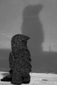 This is a knitted Maltese Falcon, though it has been unkindly called a Maltese Penguin too. I used a low desk lamp to try for a Noirish shadow.