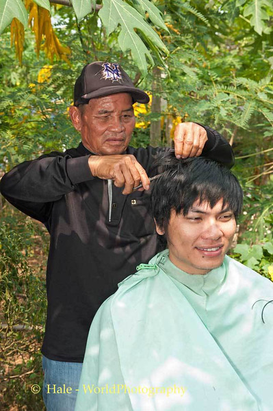 An Uncle Cuts His Nephew's Hair As Part of the Funeral Ritual