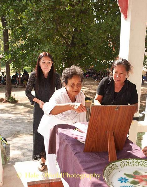 Lao Loum Woman Makes Monetary Offering