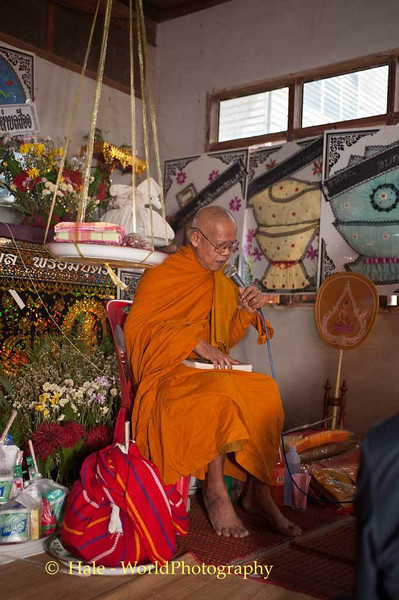 Buddhist Abbott Recites Scripturefor his Brother
