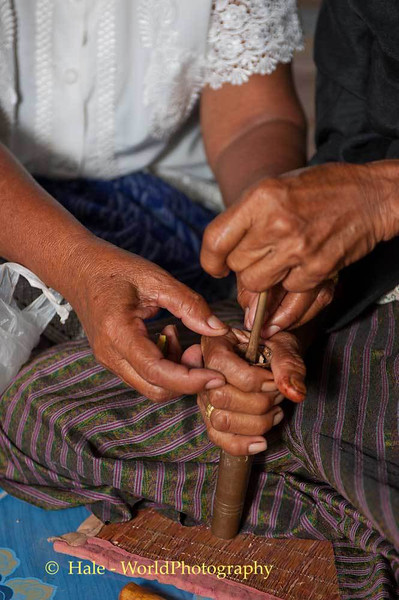Woman Prepares A Plug of Betelnut for Chewing