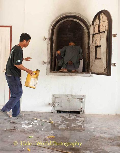 Two Men Prepare the Body for Cremation