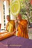 Buddhist Monks Accepting Robes