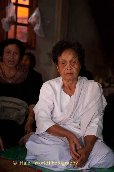 An Elderly Lao Loum Woman Mourns Her Brother's Death