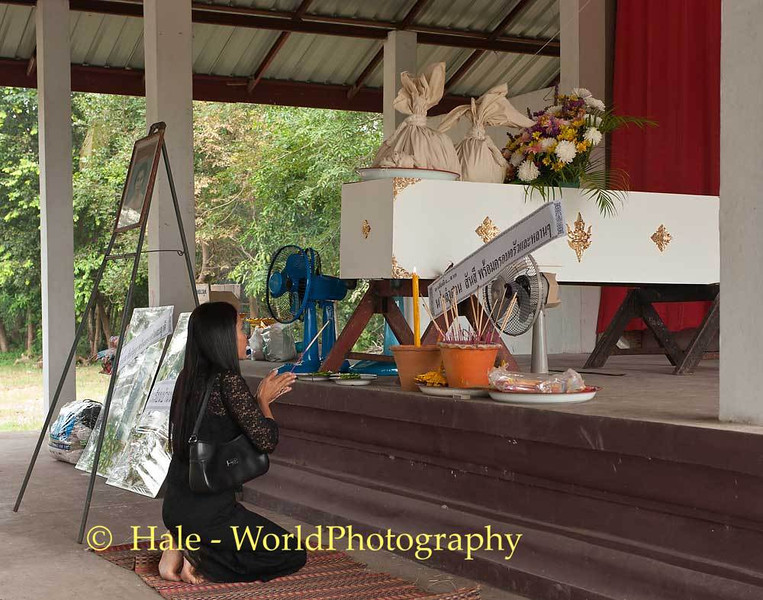 Lao Loum Woman Offers Prays In Front of Coffin