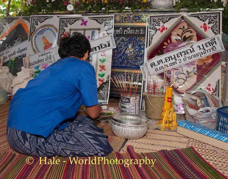 Lao Loum Woman Makes Offering In Front Coffin