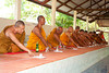 Monks Accepting Monetary Offerings With Daisaisin Connecting to the Coffin
