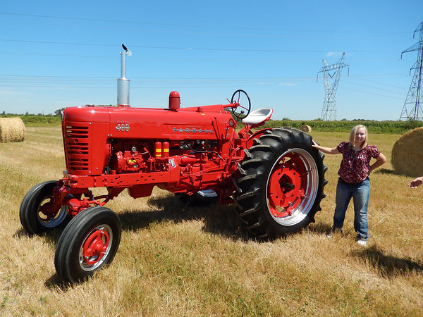 Lyndsey Young with her dad's 1956 Farmall 400 Diesel.<br /> <br /> Photographer's Name: Terry Young<br /> Photographer's City and State: Pendleton, Ind.