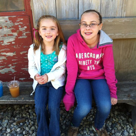 My stepdaughter Allie Ridenour and my goddaughter Morgan Ritenour at the pumpkin patch having a apple sushie.<br /> <br /> Photographer's Name: Holly Ridenour<br /> Photographer's City and State: Anderson, Ind.
