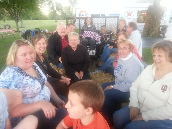 The Madison Park Stephen Ministers enjoyed a hayride at the home of Terry and Sherry Minton. They took a drive near Mounds State Park. The people who enjoyed it, from left: Heather Imel, Aartje Walters, Judy Nave and her husband, Russ Miller, Arlyne Wells, Rosalinda Wells, Sherry Minton, Bill Eggert, Vicky Barber, Norma Bonisa, Cherie Ritz and Austin Imel. <br /> <br /> Photographer's Name: Rosalinda Wells<br /> Photographer's City and State: Anderson, Ind.