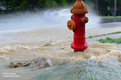 A close-up view of the broken fire hydrant just down the street.