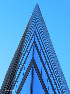 This is another photo I made of the Bank of America building after stepping back a few feet from the corner where I made the previous photo. It appears to me that there is a slight curve in the building close to the top.