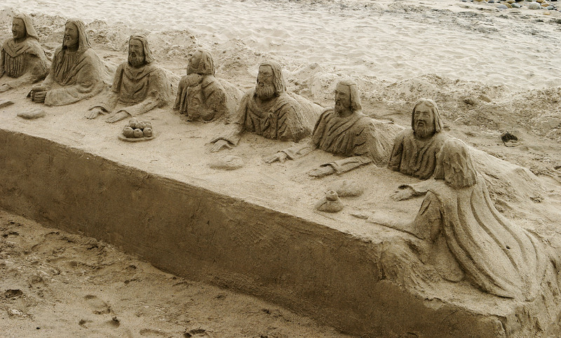 A sand sculpture of the Last Supper on a beach in Mexico. This form of sand castle is very creative.