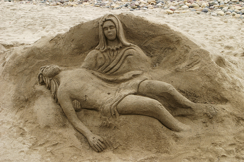 A sand sculpture of Jesus and Mary on a beach in Mexico. This form of sand castle is very creative.