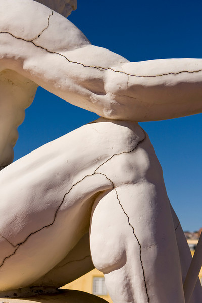 A detail view of one of the ornamental roof sculptures on the old fortress of the Castle of Good Hope in Cape Town, South Africa. The cracks run throughout the figure and help outline the muscles.