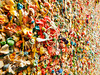 A detail view of a portion of the famous bubble gum wall in Post Alley near the Pike Place Market in Seattle. This landmark has built up layers of chewing gum over the years in colorful abstract pattern.