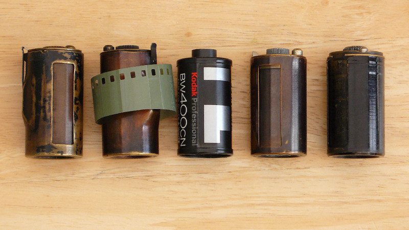 Reloadable cassettes; from the left an early Leica version (FILCA), the later one called the 1B, a modern one, a Leica M Series one and, finally, a Contax one.<br /> <br /> The main difference is the height of the container. For Leicas with the screw thread lenses the taller ones are needed or else a (felt) spacer in the gap at the bottom of the camera. The older ones are a fraction of a millimetre under 47mm across the container (ignoring the spool end). Modern ones are about 42½mm, hence the need for a spacer. Best done as two spacers, one at the top and one at the bottom, imo.<br /> <br /> The Contax ones are easiest to fill in the dark and there's a lot of clones made in the old USSR that are both cheap and plentiful.