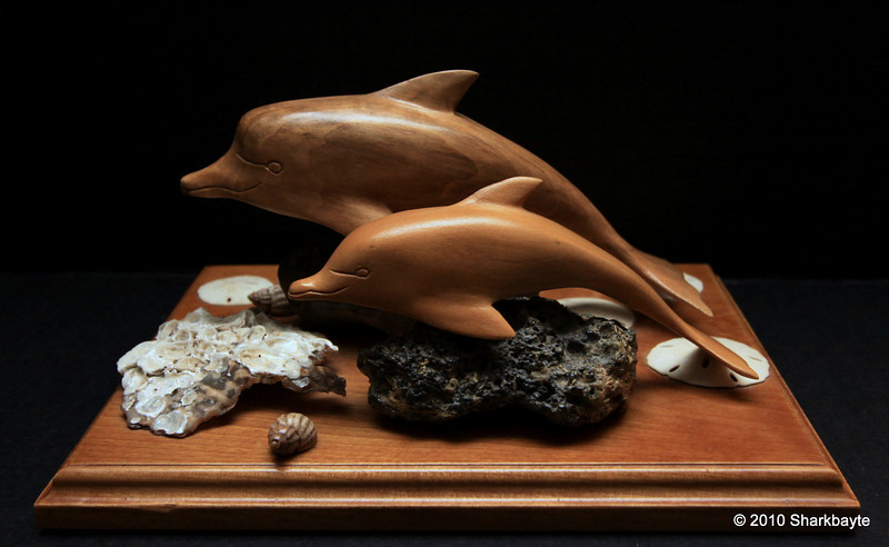 Day 182-The dolphin family. I received this today, it was whittled and made by a close family friend.  Thank you Mr. Forder, this is awesome!! #365Project (2010.07.01)
