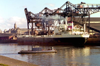 The Finnieston Ferry, with the freighter Victore at Mavisbank Quay.  Glasgow, 16/03/77  ~ The grandiose Co-op warehouse on the left is still there (now loft apartments), and a bit of the Kingston Bridge is visible, but everything else is changed utterly.