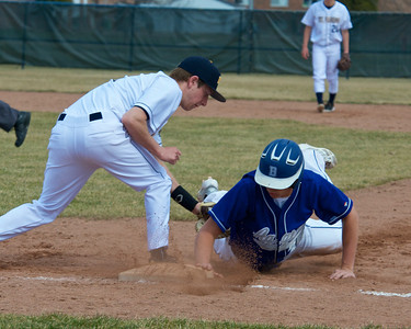 Skip Traynor - Special to the Sun Beal City's Ryan Tilmann gets back to first base before the tag by Mt. Pleasant's Max Heeke during one game of the Oiler Tourney at Mt. Pleasant High School Saturday, April 12, 2014.