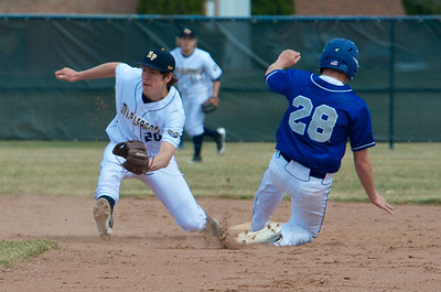 Skip Traynor - Special to the Sun Beal City's Ryan Tilmann (28) safely takes second ahead of the tag by Mt. Pleasant's Zach Heeke (20) during one game of the Oiler Tourney at Mt. Pleasant High School Saturday, April 12, 2014.