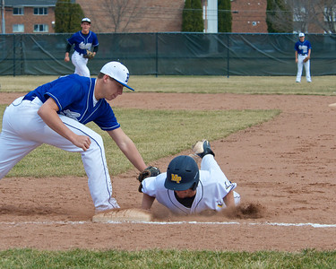 Skip Traynor - Special to the Sun Beal City first baseman Ryan Tilmann tries to apply the pick-off tag to Mt. Pleasant's Robert Backus during one game of the Oiler Tourney at Mt. Pleasant High School Saturday, April 12, 2014.