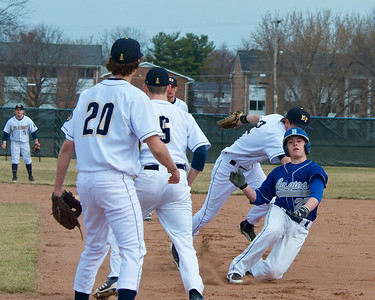 Skip Traynor - Special to the Sun Beal City's Jake Matthews (27) is caught in a rundown between first and second and tagged out by Mt. Pleasant's Max Heeke (2) during one game of the Oiler Tourney at Mt. Pleasant High School Saturday, April 12, 2014.