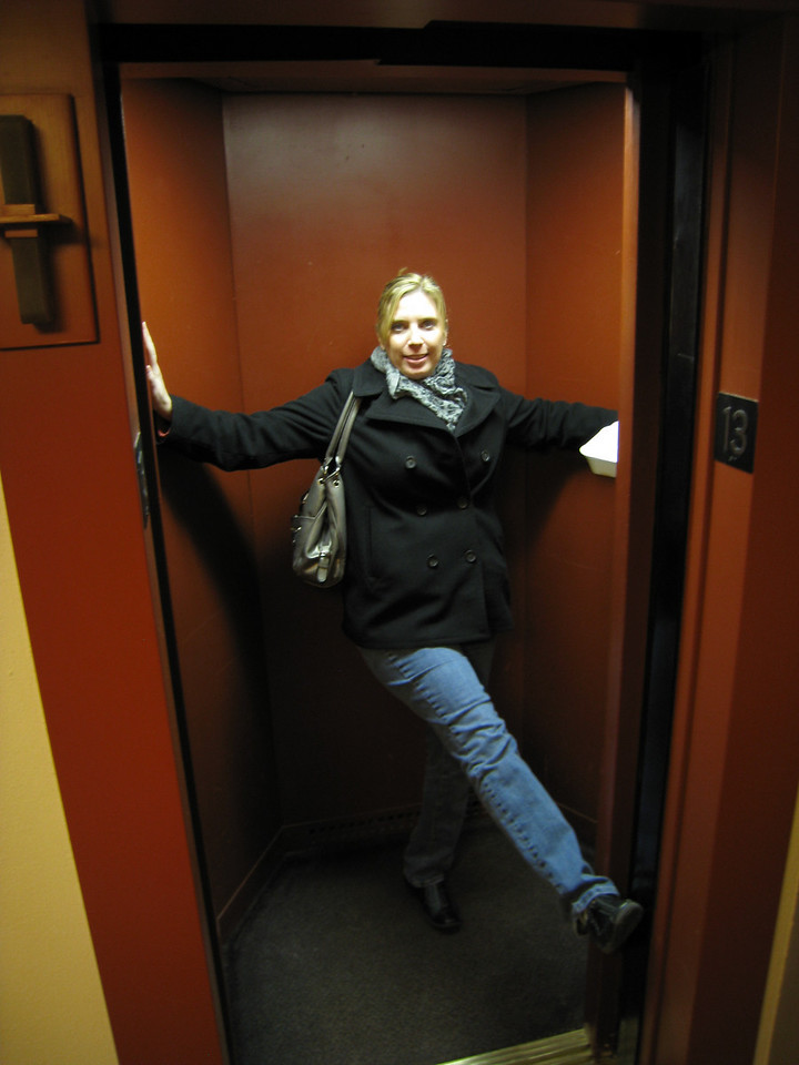 Deena showing how small the Price Tower elevators are...