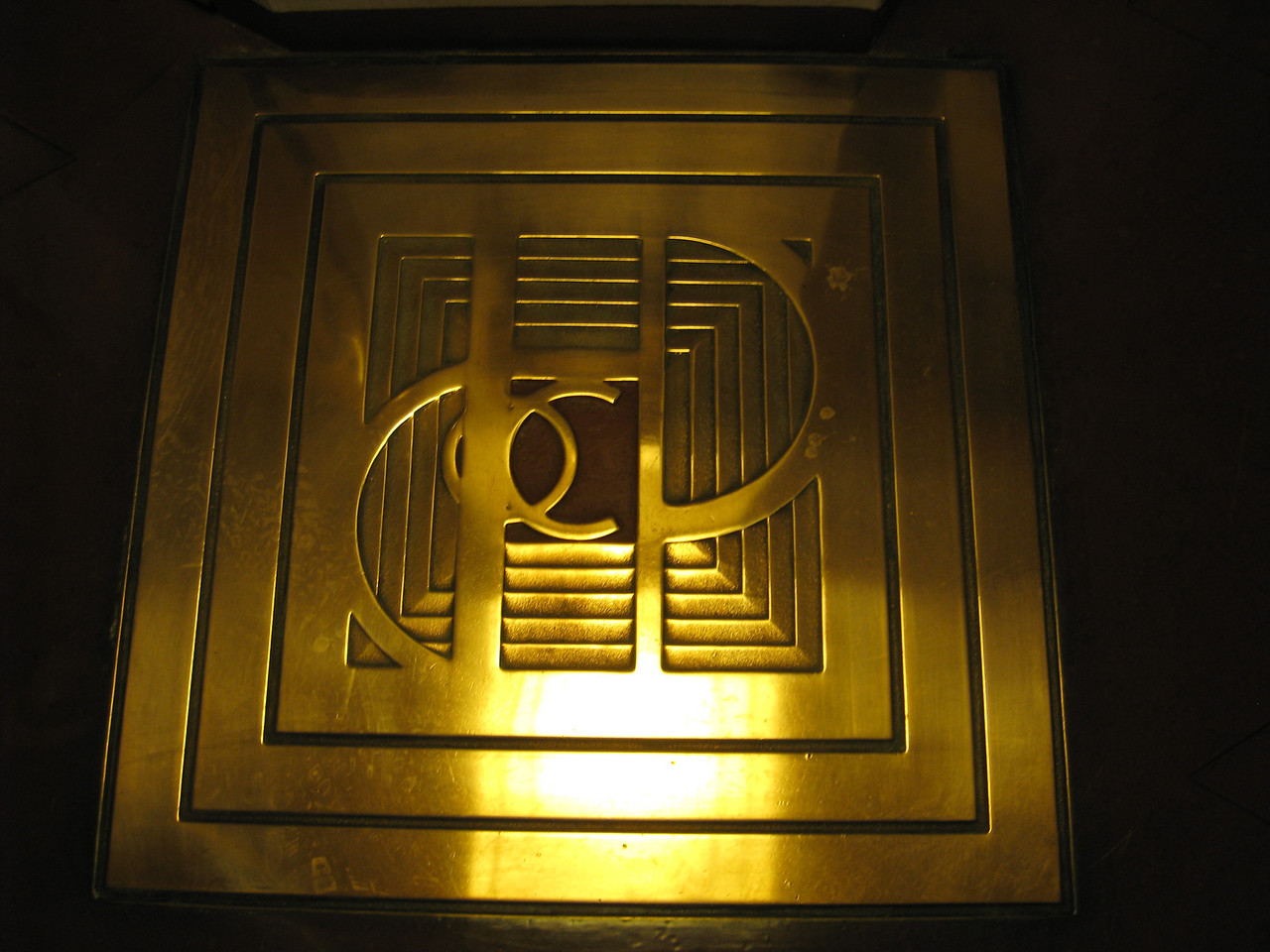 Harold C Price corporate logo on the floor on each floor of the Price Tower.