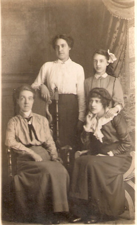 "Seated left: Eleanor Horner (nee Kelsey). Standing left: Alice Horner. Standing right: Gladys Horner. Seated right: probably ""May"" referred to in Fred Horner's last letter home and possibly Fred's 'sweetheart'. This group photo is possibly a soldier's keepsake and specially taken before entering the theatre of war."
